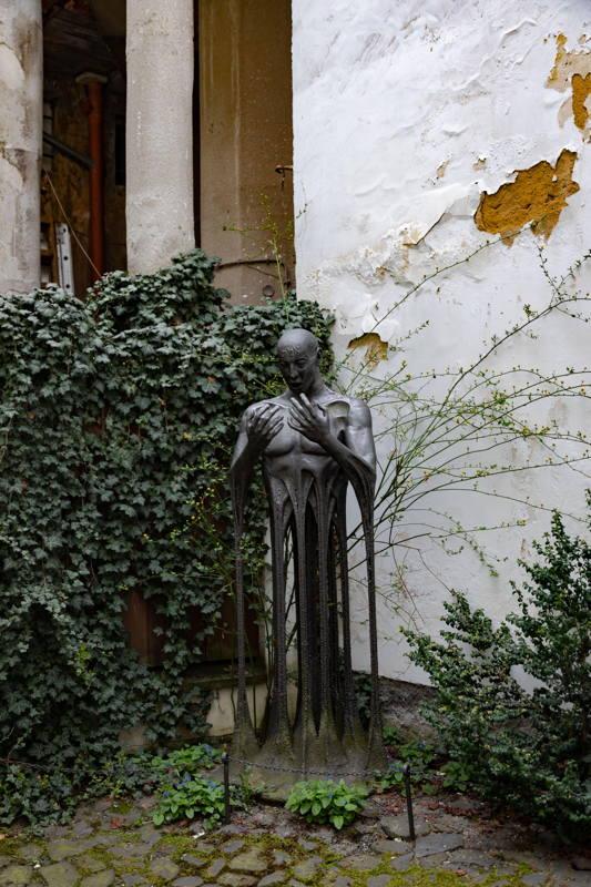 modern statue of golem in small garden