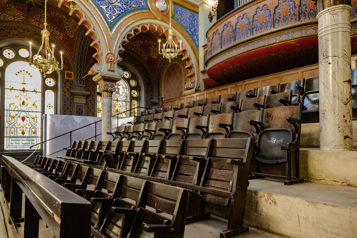 pews from former synagogues to replace originals. During Shoah used for furniture storage by Nazis.