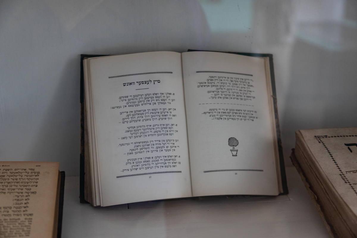 prayer books in display case