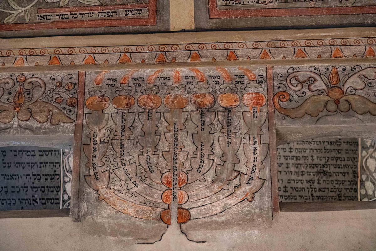 beautiful mural paintings and Hebrew prayers cover the ceilings, vaulted archways, wall
